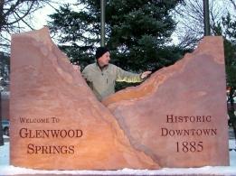 Martin Cooney, author martincooney.com, with Glenwood Springs Entrance Sign