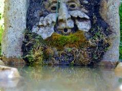 Green Man Solar Fountain, Winterset Limestone Sculpture by Martin Cooney, stone sculptor