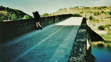 Kris Cooney peers from a bridge along The Way