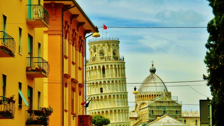 First Glimpse, Leaning Tower, Streetscape, Downtown Pisa, Along The North West Tuscan Way by Martin Cooney