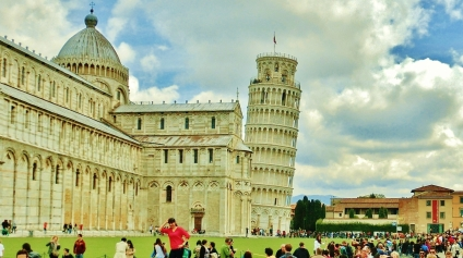 Merry throngs swarm around The Leaning Tower of Pisa, Italy, on the North West Tuscan Way by Martin Cooney