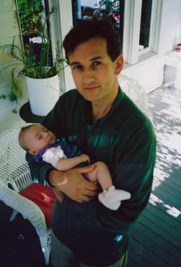 Martin Cooney with newborn son Joseph, front porch of SE Portland home, Oregon