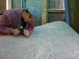 Martin Cooney cuts in the hand cut lettering on the Glenwood Sprints entrance sign