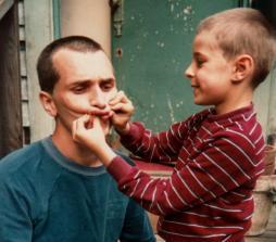 Martin Cooney receives facial improvement from Kris's son Bill, Simon Benson House, Portland, Oregon