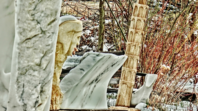 Oblique Perspective, a Snowgoyle, Mabel, Leaning Tower of Woody Creek, Troy.