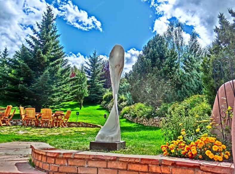 Maypole, newly installed in the hills above Aspen. Curvilinear Colorado Yule Marble Sculpture by Martin Cooney