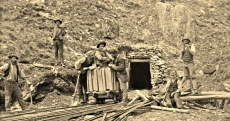 Miners, pose at entrance to mine3