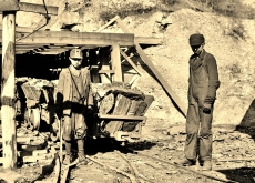 Miners, young boys at entrance to mine (3)