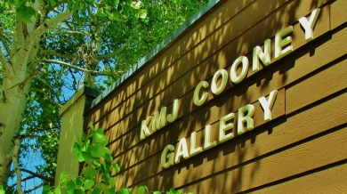 KMJ Cooney Gallery Sign, Fronting Highway 82 Across From The Airport