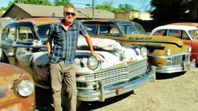 Martin Cooney, author martincooney.com, poses with vintage car, Delta, Colorado